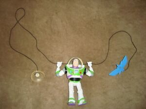 Disney Toy Story Buzz Lightyear Figure attached to a string w/suction cup Mattel