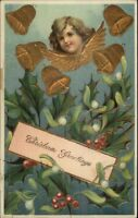 Christmas - Child's Face Gold Angel Wings & Bells c1910 Postcard