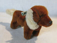 Vintage stuffed dachshund toy with glass eyes and hard plastic nose
