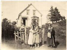 Mature Women Friends Ladies Hugging Outside Farmhouse VOGLERS COVE Nova Scotia?
