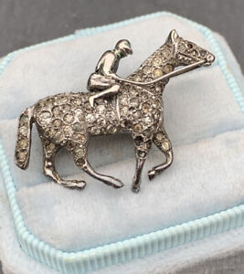 Antique Sterling silver horse and jockey brooch.