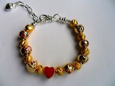 Unusual  Silver Chain Charm Bracelet with Gold Plated Emoji Charms and Spacers