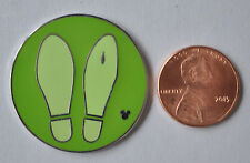 This Hidden Mickey Disney Pin Round and Green with two footptints
