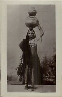 India Native Woman Costume Maid Water Carrier c1910 Real Photo Postcard dcn