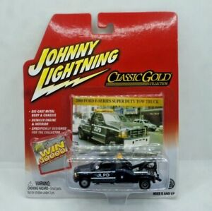 Johnny Lightning Classic Gold 2000 Ford F Series Super Duty Tow Truck NEW