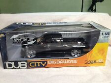 "1/18 JADA Dub City 2003 Dodge Ram Extra Cab P.U. in Met.Black tan Int 24"" Dubs"