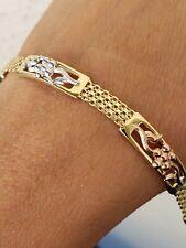 14k gold flower bracelet 7.25 Inches Long womans yellow white rose