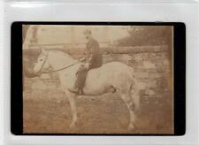 Photograph of a man on a horse (C29284)