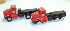 Two construction flatbed toy trucks, one for play, one for parts