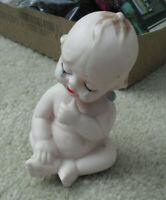 "Vintage Porcelain Crying Kewpie Girl Sitting Figurine 4 1/4"" Tall"