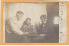 Real Photo Postcard RPPC - Man and Boy Play Checkers - Girl Watches