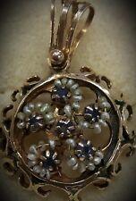Pendente in oro, perle e zaffiri blu. Pendant in gold, pearl and blue sapphire.
