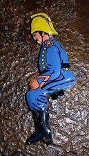 Figurine ancien jouet pompier en tôle lithographié