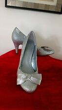 Gianni Bini 7.5M silver sparkly pumps with silver ribbon lacing & bow