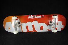 Almost Complete Skateboard SAF Titanium Trucks Side Pipe Red 8.25 Grizzly Abec 9