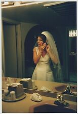 Found PHOTO Young Wedding Bride Fixing Earring In Bathroom Mirror