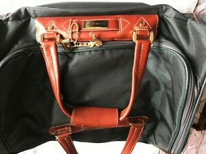 Samsonite travel holdall. Green with Tan Leather straps and trim. New - Bargain