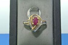 Women's 10k yellow gold ruby solitaire and diamond ring .25 carat oval ruby ring
