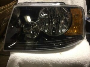 HEADLIGHT-ASSEMBLY LEFT/ DRIVER SIDE TYC 20-6398-90 FOR 03 - 06 FORD EXPEDITION