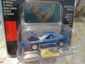 1996 firebird met. blue Racing Champions mint edition issue 43 w/stand  1:60