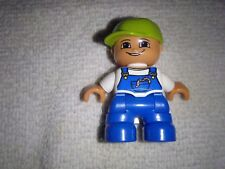 Lego Duplo  - Toddller./Baby wearing blue (denim) overalls a white shirt & cap