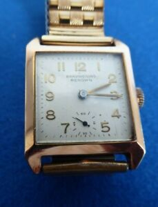 VINTAGE  BRAVINGTONS  9CT GOLD 'RENOWN' SQUARE SHAPED WRISTWATCH.