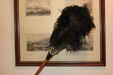 One (1) inverted black ostrich feather duster 70cm overall wood stained handle