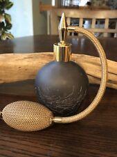 A new art  deco perfume bottle atomizer with Brown tassel in Dark Brown glass