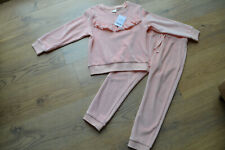 Girls  Pink velour tracksuit.  Age 3-4 years.  NEW.  NEXT