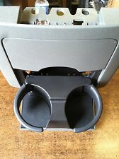 NEW OEM 2005-2013 NISSAN FRONTIER REAR CUPHOLDER ASSEMBLY (STEEL COLOR)