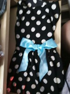 NEW DOG DRESS ,IN BLACK WITH WHITE DOTS AND LARGE BLUE RIBBON. SIZE L ?.