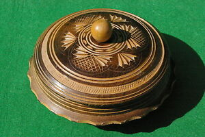 A  DECORATELY TURNED WOODEN DISH WITH LID STAINED AND RECUT DESIGN