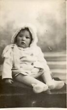 Baby sitting up wearing hat and coat Studio Photo Postcard (18FAM)