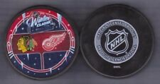 DUELING 2009 WINTER CLASSIC CHICAGO BLACKHAWKS vs DETROIT RED WINGS PUCK - #ACL