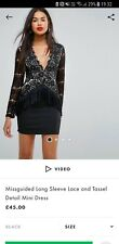 Black long sleeve lace and tassel mini party dress