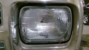 86-94 Chevy S10 Blazer Driver Left Headlight OEM