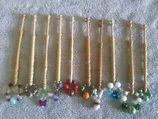 10 Light Wooden Lace Bobbins With Spangles