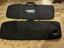 Two kiteboard bags, CABRINHA 135 and SURREAL 155.