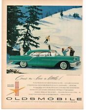 1956 Oldsmobile Golden Rocket 88 Holiday 2-door Sedan Skiers car Vtg Print Ad