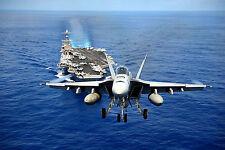 F/A-18E Super Hornet from Tophatters Flies over Carrier USS John C. Stennis