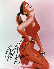 KRISTY SWANSON, ACTRESS AUTOGRAPHED SIGNED 8X10 WORKING OUT IN RED WITH COA