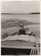 1959 Cute little boy drives motor ship boat fashion old Russian Soviet photo