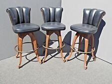 Three Vintage Mid Century Embossed Shield Black Swivel Barstools Spanish Style