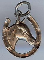 VINTAGE STERLING SILVER HORSE HEAD IN HORSESHOE CHARM