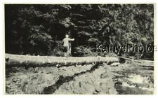 FOUND B&W PHOTO G_8539 MAN WALKING ON A LOG IN WOODED AREA AT CAMPBELL FALLS