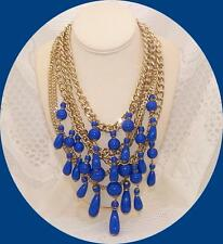 Gold tone Multi Chain Necklace with Sapphire Blue Dangling Beads.