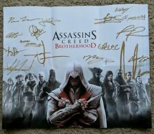Assassins Creed Brother Hood signed poster and art book.