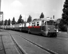 PHOTO  NETHERLANDS TRAMS 1959 ROTTERDAM ROSESTRAAT RTM M TRAM NO 1806 AND TRAIN