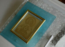 Table top frame display of etched reflection of Jesus in gold-plated foil