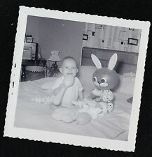 Antique Vintage Photograph Little Baby Sitting on Bed With Blow Up Bunny Rabbit